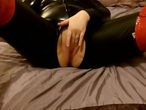 Mummy dirty wife banging her shaven pussy in pvc catsuit and red thigh high boots