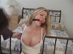 Hussy struggles helplessly tied to her bedpost