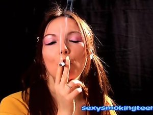 Sensual brunnete sizzling teen smoking for your enjoyment