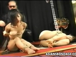 Two Asian vixens are tied up poked and proded