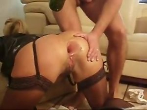 Wild butthole fisting with hand and wine bottle and he jacks off in her bum