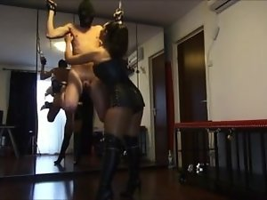 Mistress tickling chained hanging man