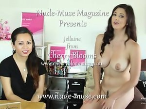 A nude young lady interviewing a clothed young woman