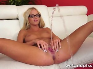 Nice looking blondie in glasses uses a jelly toy on her dripping vagina to orgasm
