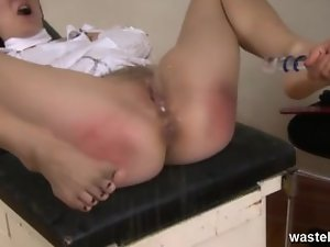 Tempting blonde nurse plays with rectal ass plug in her patient