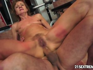 Grandma rides on a huge 18 years old cock.