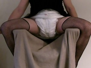 Black dress , fishnet stockings and diapered