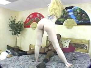 Pale blond whore riding large black pecker