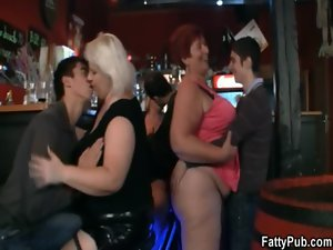 Plumper girls have fun in the bar