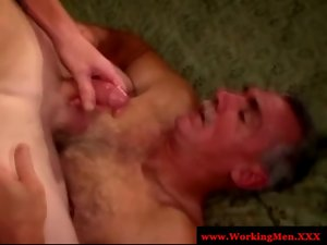 Attractive mature gay duo give each other facials