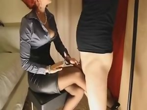 Aged redhead gives her slave vixen a footjob