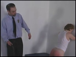 Encased vixen gets her bum spanked