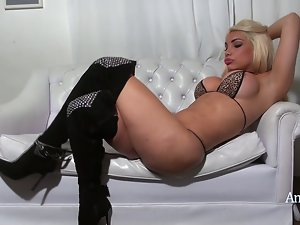 Angeles Cid in boots and a bikini