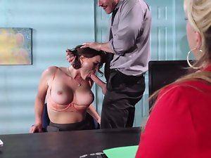 A female that has large knockers is getting banged absolutely rough on the desk