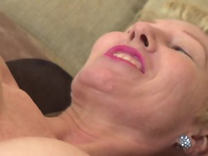 A filthy granny is by herself, playing with her sensitive sexy fanny