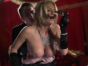 A tempting blonde hussy is getting banged absolutely brutal in the opera house