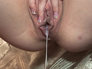 A light-haired is wet moist with cum after she gets cumshot by her lover