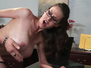A big titted girl with glasses is opening up her muff to get grinded
