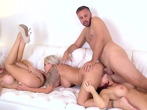 An orgy is filmed with some absolutely buxom and nice looking wenches