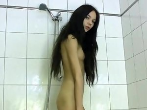 Perfect raven haired vixen teasing her smooth petite pussy