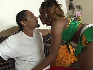 A black female caresses a penis and she also gets fondled by a man