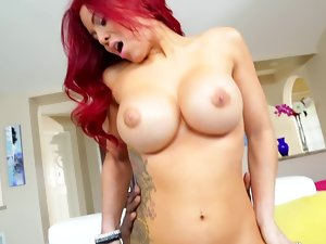 A redhead with a awesome artificial large rack is taking on a large shaft