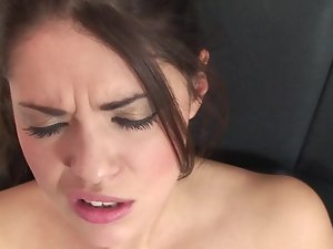 A thin wench with a wild rack is using a large vibrating sex toy on her cunt