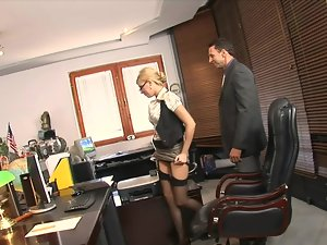 A female is getting penetrated in the office by her large boss