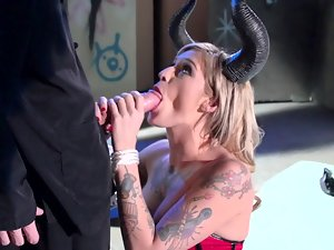 Blondie with horns is getting a prick in her mouth in her dungeon