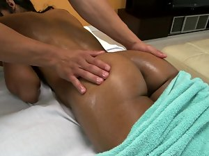 Girl with a fit body is getting her twat massaged on the table