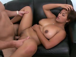 Latina shakes her massive natural knockers and her large behind