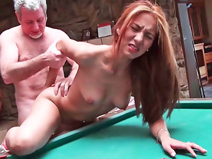 Dark haired is having some attractive sex on the pool table here