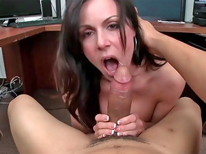 Charming bitch Kendra Lust caresses a solid cock with her hooters