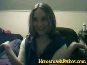 Smiling tempting blonde strips for the webcam