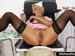 Luscious Attractive mature Nurse in uniform playing with her snatch