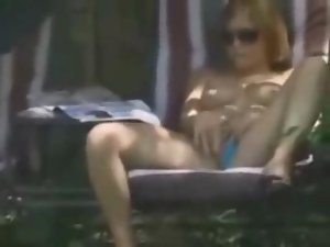Attractive light-haired caught masturbating in her backyard by a peeper