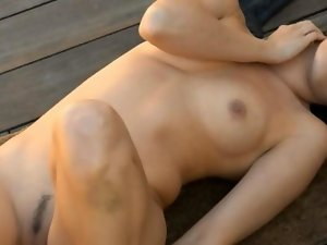 Wench rubbing the clit behind the house film