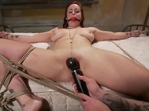 Tied down bondage skank stimulated with fingers and toys