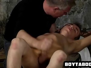 Alluring tied up hunk getting his penis tugged on feature