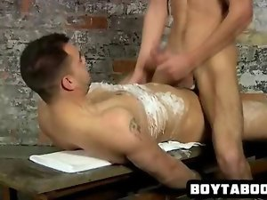 Alluring hunk riding a tied up and wax covered hunk