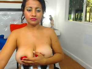 Latina plays with her extremely large tits in nip pasties