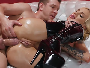 Blonde MILF is in her latex pants and with a cock in her ass