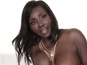 Busty black diva believes that man's big cock will satisfy her