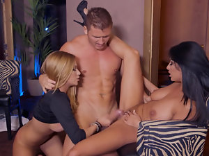 Two girls with sizable boobs make a guy happy by spreading their legs